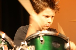 Image of drumming boy | Cathy Lea